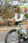 Michael Weiss competing in the bike portion of the 2011…