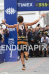 Jesse Thomas celebrates down the finish shoot at the  Ironman…