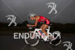 Linsey Corbin bikes in the rain at the  Ironman 70.3…