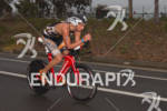 Jesse Thomas on bike at the  Ironman 70.3 California on…