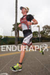 Paul Ambrose on run at the  Ironman 70.3 California on…