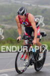Leon GRIFFIN climbs at the  Ironman 70.3 California on March…