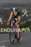 Jason Smith on bike at the  Ironman 70.3 California on…