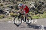 Adam O'Meara competing in the bike portion of the Ironman…