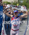 Ben Hoffman celebrates his win of  the Ironman St. George…