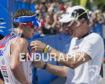 Ben Hoffman receives his medal from his father at the…