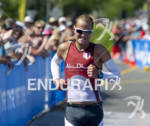 Maik Twelsiek grimaces as he approaches  the finish line taking…