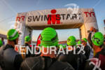 Soon to be Ironman head under the swim start arch…
