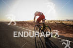 Adam O'Meara on bike at the  Ironman St. George on…