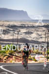Chris Macdonald climbing on the bike at the  Ironman St.…