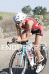 Linsey Corbin climbing at the 30th Anniverary WIldflower Triathlon -…