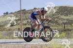 Chris Legh riding at the 30th Anniverary WIldflower Triathlon -…