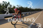 Tami Ritchie on bike at the Ironman Texas on May…