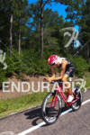 Jordan Rapp bikes through the Texas woodlands at the Ironman…
