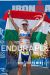 Jozsef Major holds up his national Hungarian flag at the…