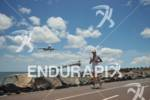 Athlete in front of a landing plane on the run…
