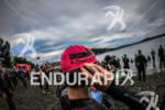 Athlete adjust swim cap before the start of the Ironman…