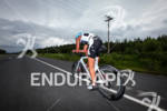 Lewis Elliot races down the road at the Ironman Coeur…