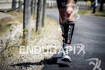 Guy Crawford's lower half on run at the Ironman Coeur…