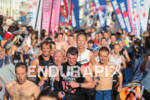 Athletes transition from swim to bike at 2012 Ironman France.