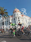 Triathletes on the bike front of Negresco Hotel
