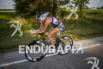 Lesley Smith riding bike at Ironman Muncie 70.3