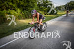 Rebekah Keat on the bike at Ironman Muncie 70.3 on…