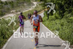 Age groupers chasing Patrick Evoe at the Ironman 70.3 Racine,…