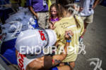 Champ Jessica Jacobs signing tshirt at the Ironman 70.3 Racine,…