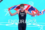 Gold Medalist Alistair BROWNLEE (GBR) crossing the finish line at…