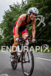 Kate Bevilaqua all smils on biike at the 2012 Ironman…