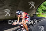 TAMARA KOZULINA races her bike at the 2012 Ironman U.S.…