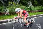 Intenste looking Kate Bevilaqua races her bike at the 2012…