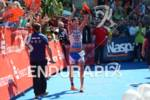 Michael Ralert celebrates in the finish chute at the Ironman…