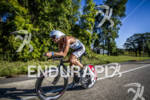 JUSTIN DAERR on the bike at 2012 Ironman Wisconsin on…
