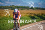 Tom Gerlach cycling through the fields at the 2012 Ironman…