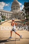 Justin Daerr running through the capitol square during the 2012…