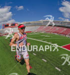 Ben Hoffman leading  the field through the Camp Randall stadium…