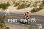 Kelly Willamson on bike in the scenic desert at the…