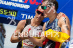 Craig Alexander shares a word with Sebastian Kienle at the…