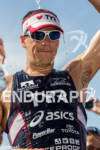 Andy Potts cools off at the finish line at the…