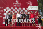 The top six female finishers on the podium at the…