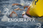Pro men battle for position at the swim turn around…