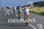 Pro men cyclists heading north on the Queen Kamehameha Highway…