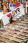 Andy Potts climbs the stairs as he exits the swim…