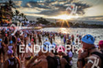 Age group athletes gather on Dig Me Beach for the…