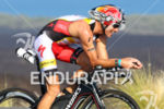Craig Alexander on bike at the Ironman World Championship in…
