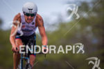 Greg Bennett on bike at the Ironman World Championship in…