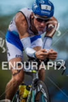 Andreas Raelert climbs on bike toward Hawi at the Ironman…