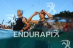 Age group athletes before the swim start at the Ironman…